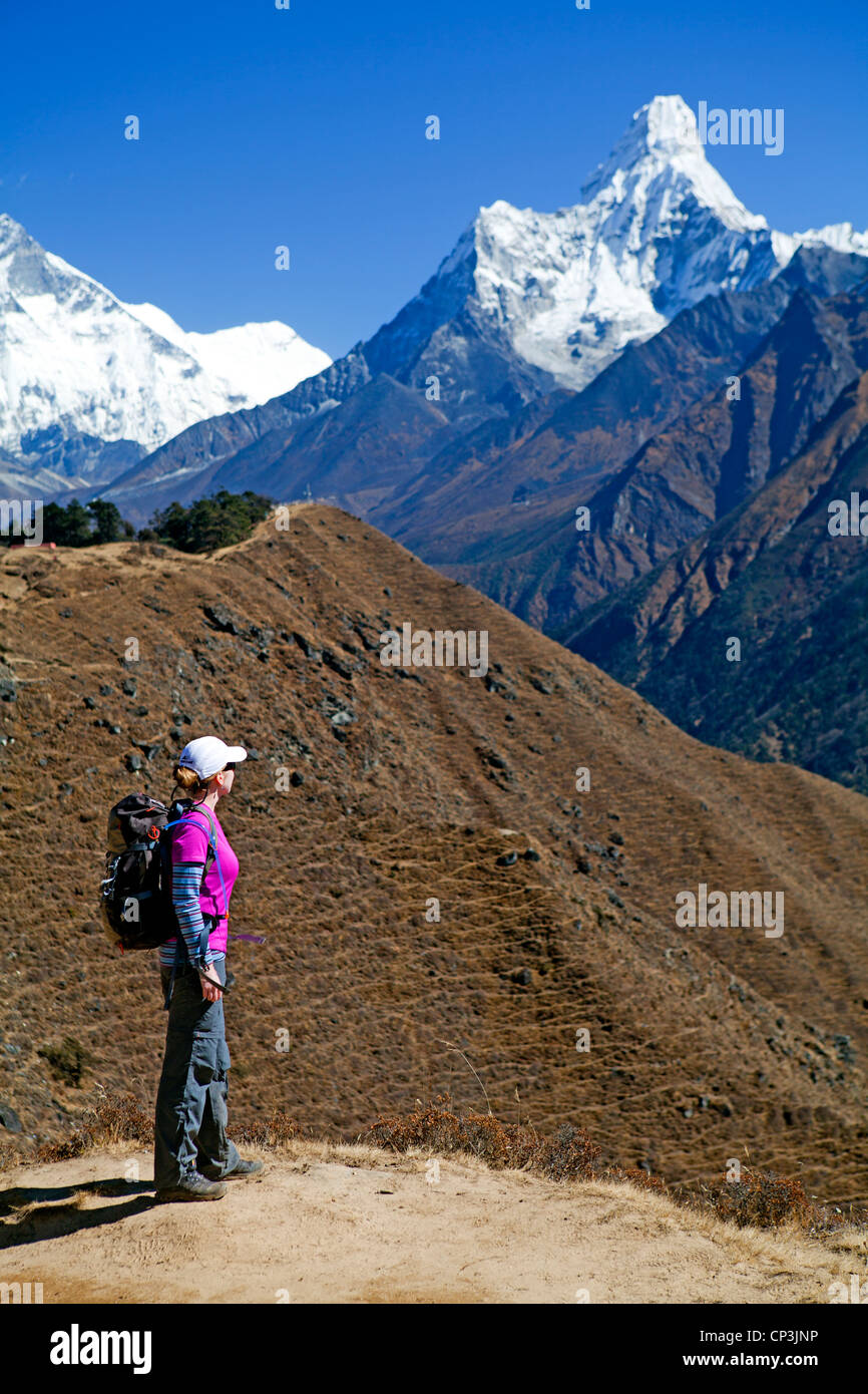 Trekker with a view to Ama Dablam, on the trail to Everest Base Camp - Stock Image