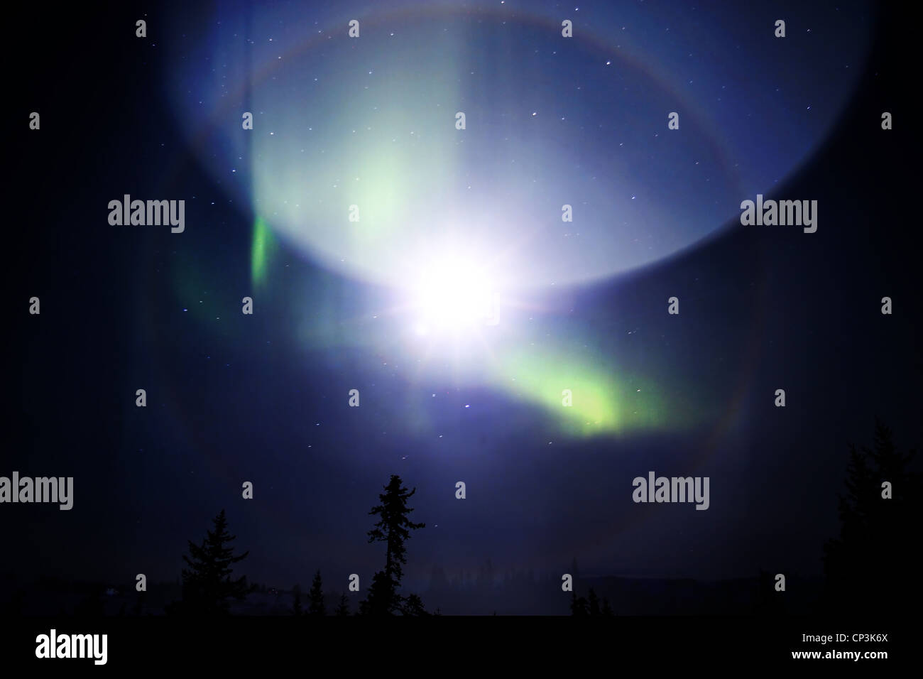 Strange phenomenon in in the sky with a science fiction look created by layering photos. - Stock Image