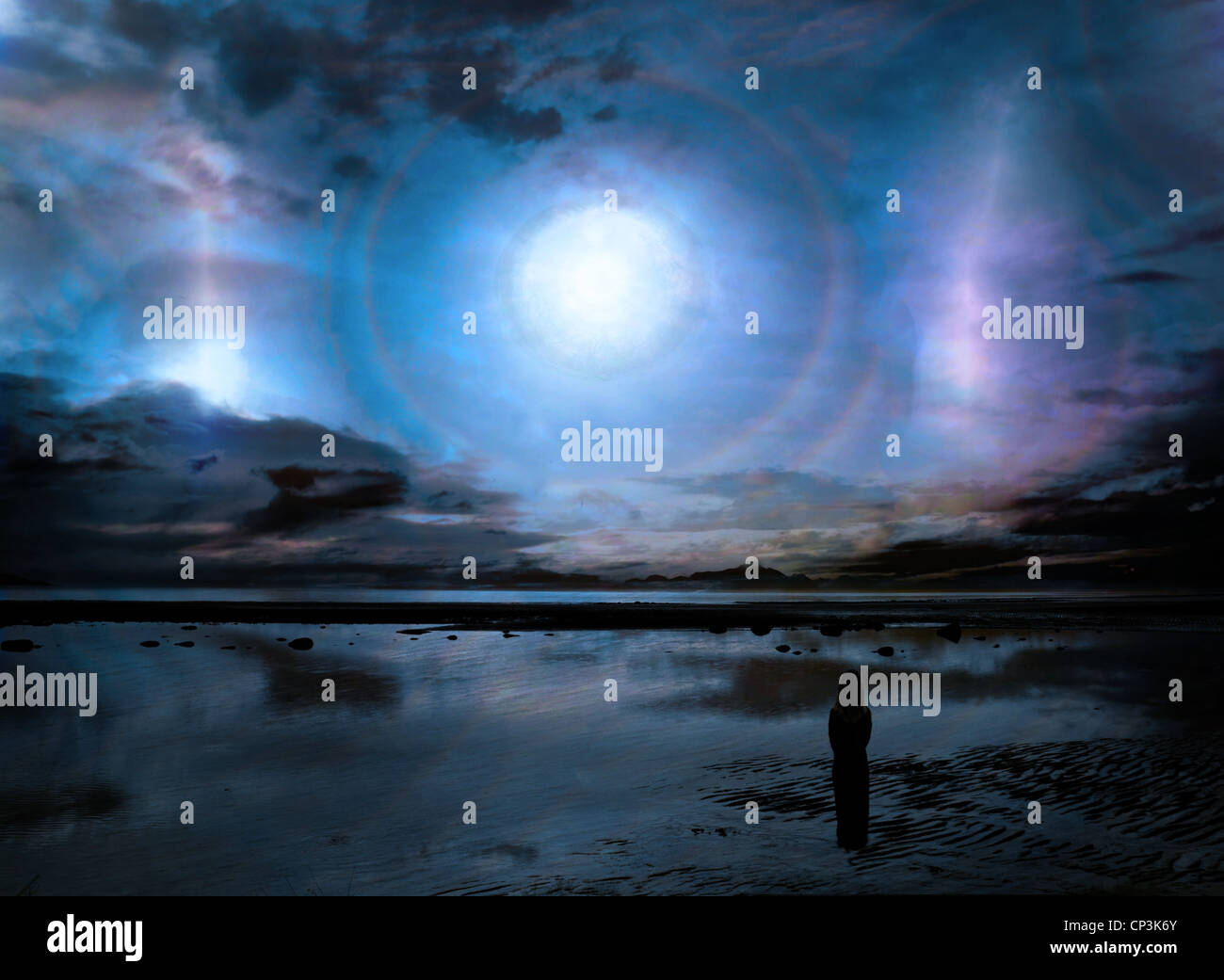 Fantasy science fiction scene with an amazing sky and a silhouetted woman observing it. - Stock Image