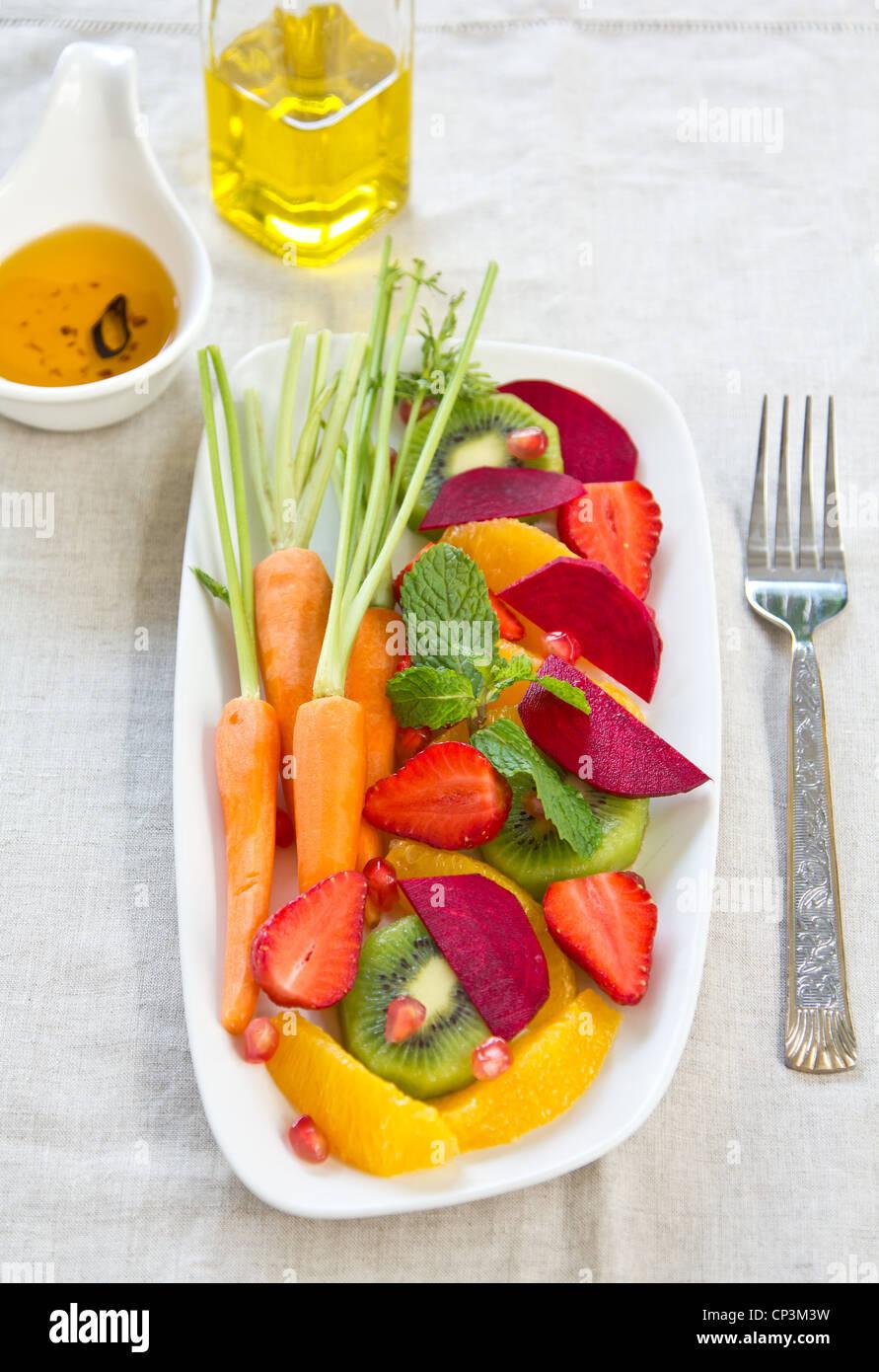 Super salad [Strawberry,kiwi,beet,orange] - Stock Image