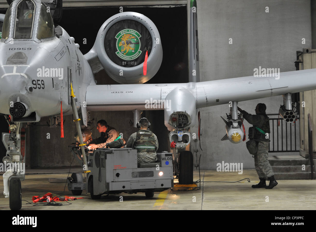 Members of the 25th Aircraft Maintenance Unit load munitions onto an A-10 Thunderbolt II during Beverly Midnight - Stock Image