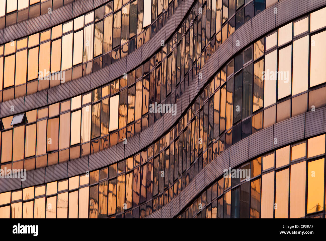 Curves of a building with mirror glass windows, Manchester, England, UK - Stock Image