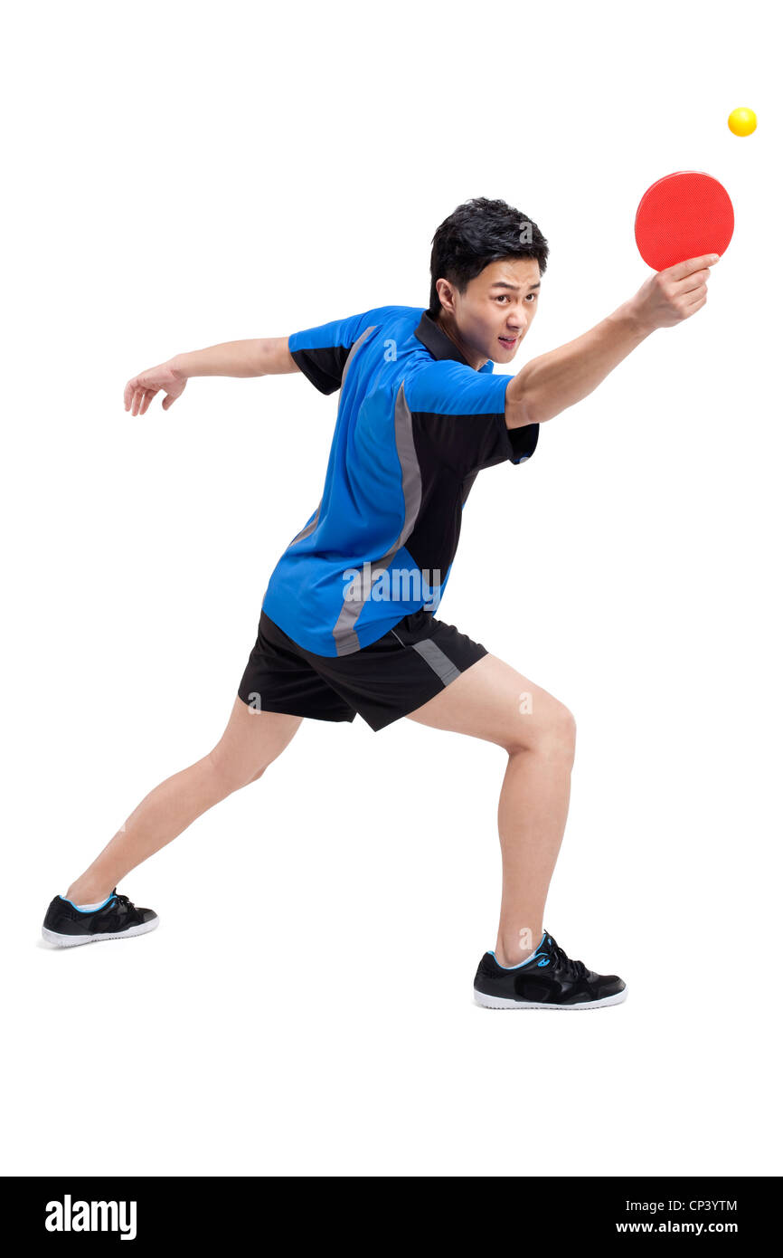 Table tennis player bounces ball on paddle - Stock Image