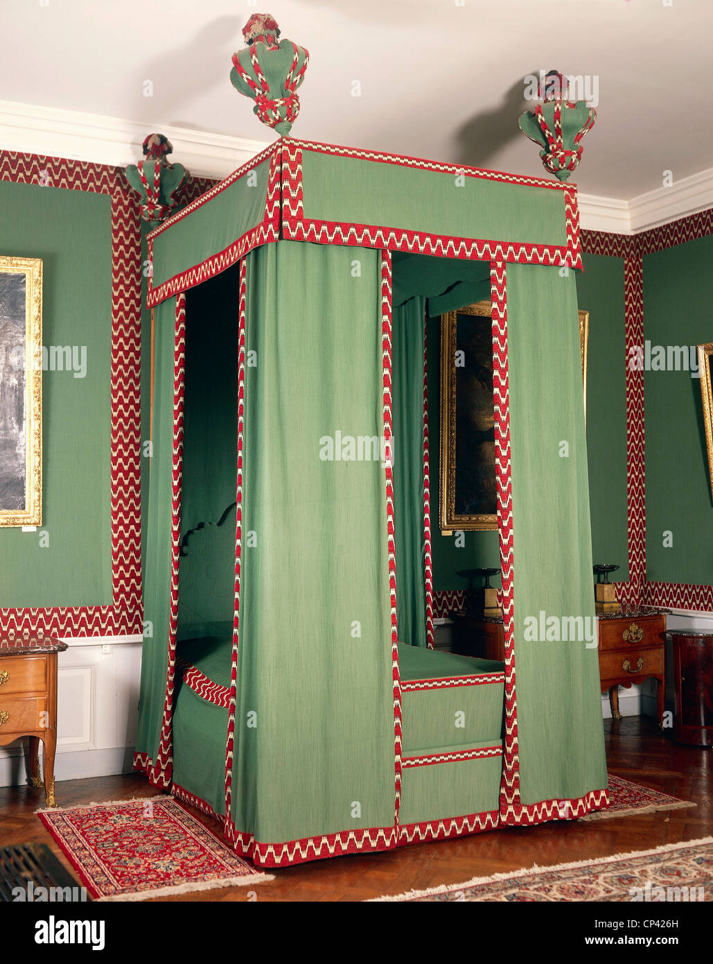 France, the seventeenth century. Four-poster bed in the style of Louis XIII (the upper canopy of the time, the rest - Stock Image