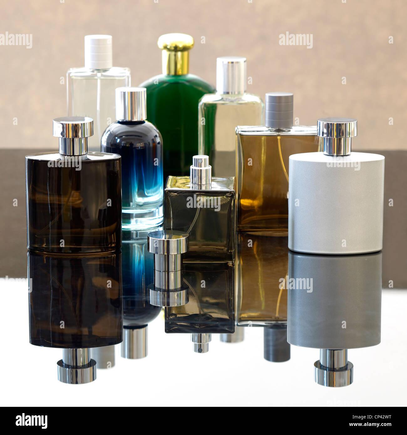 A still life shot of several mens aftershave bottles - Stock Image