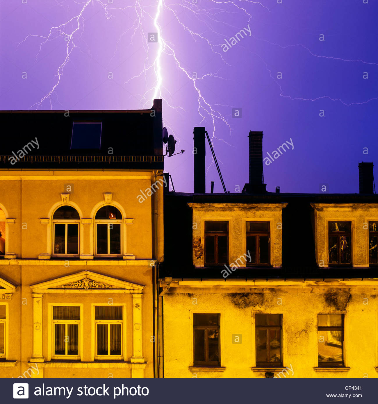 Lighting strikes over buildings in Plagwitz, Leipzig, Saxony, Germany - Stock Image