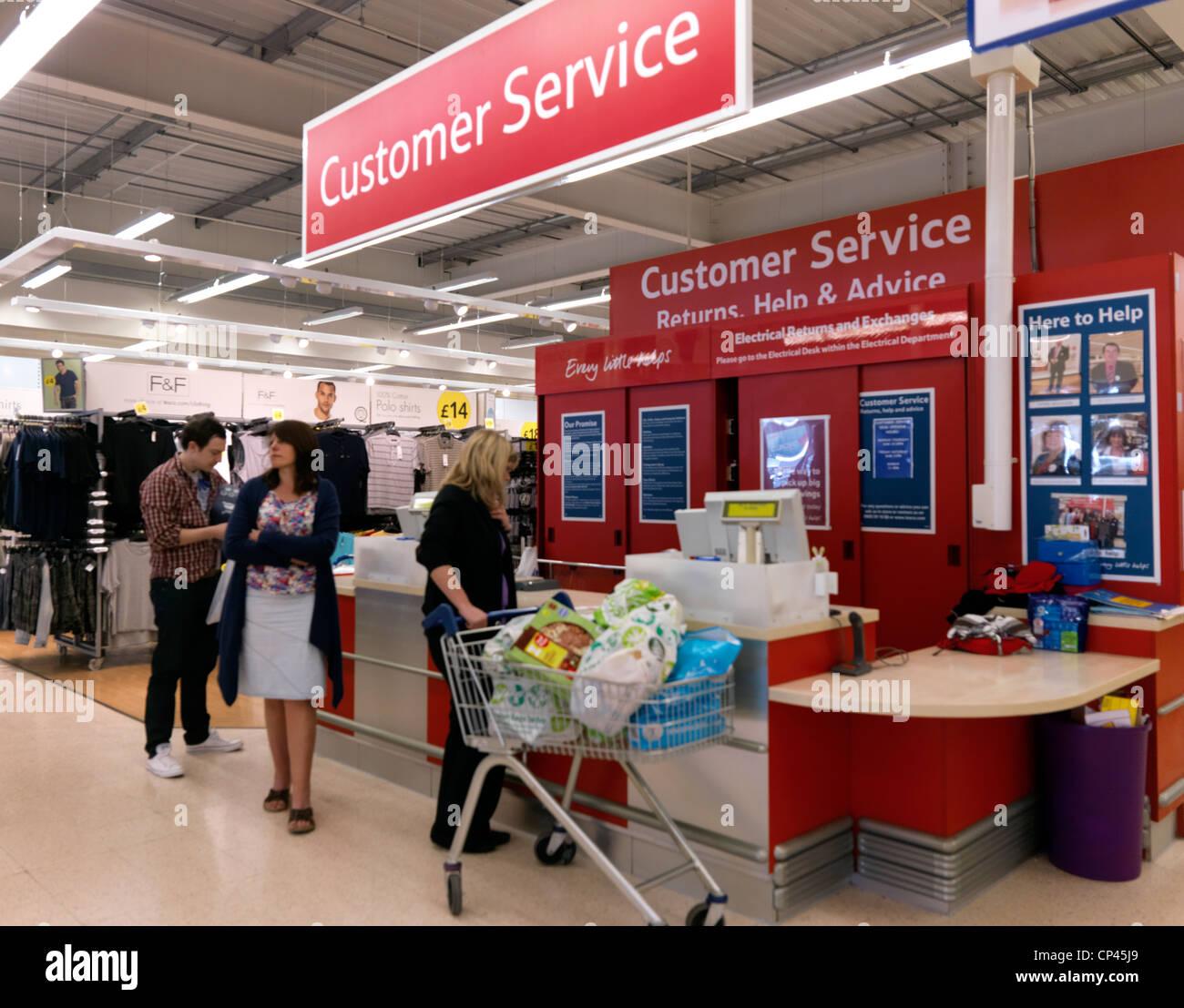 customers at customer service desk tescos supermarket. Black Bedroom Furniture Sets. Home Design Ideas