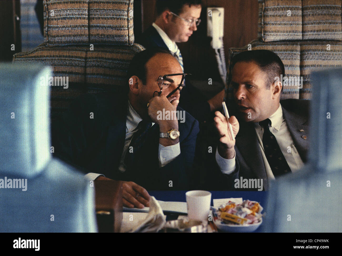 Nixon Inner Circle advisors John Ehrlichman and H. R. Haldeman on Air Force One three days before they would be - Stock Image