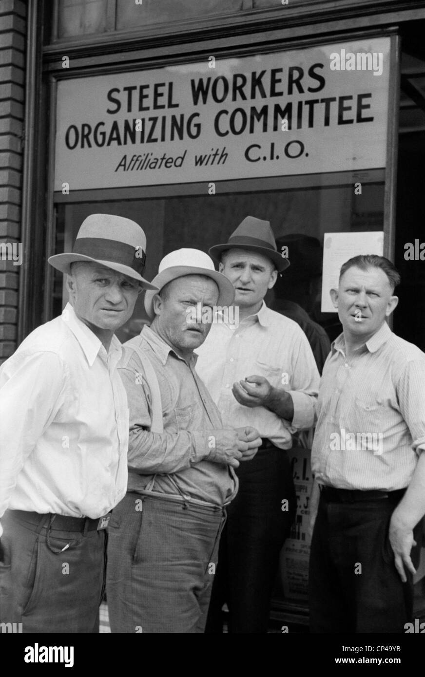 Steelworkers at a Union storefront. The National Labor Relations Act of 1935 gave labor unions unprecedented rights - Stock Image