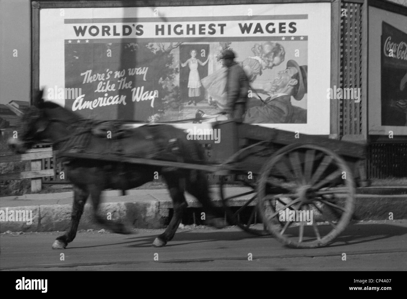 Horse drawn cart against an billboard in Memphis during the 1937 flood. The politically motivated pro-business reads - Stock Image
