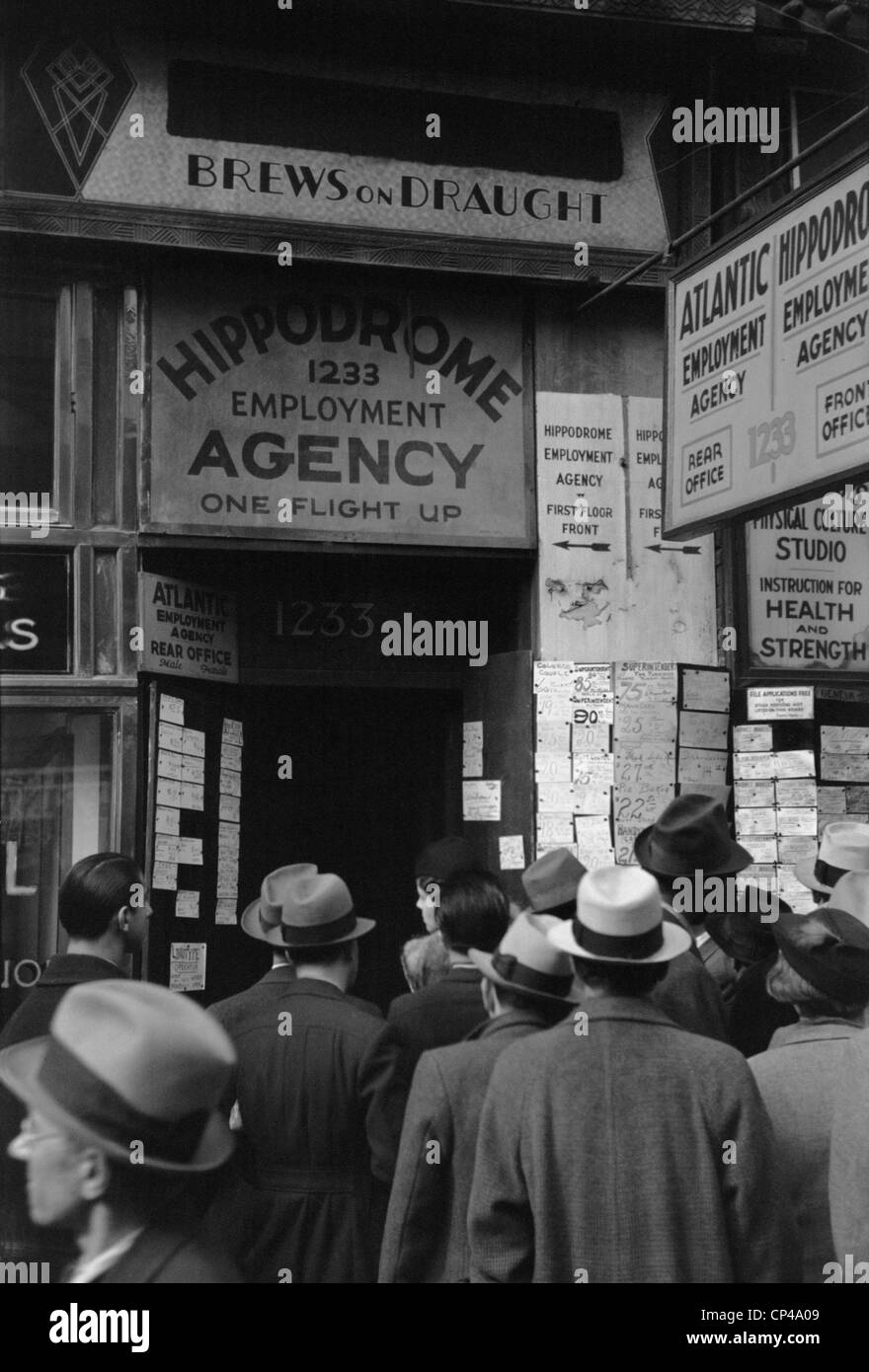 Crowd of job seekers at the Hippodrome Employment Agency at 1235 Sixth Avenue. New York City Dec. 1937. - Stock Image
