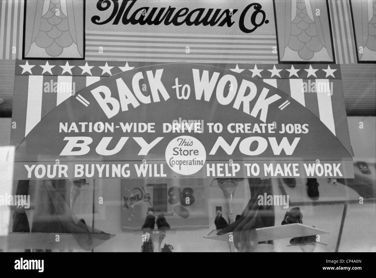 Store sign using economics theory to advertise. Sign reads 'Nation-wide drive to create jobs' and 'Your - Stock Image