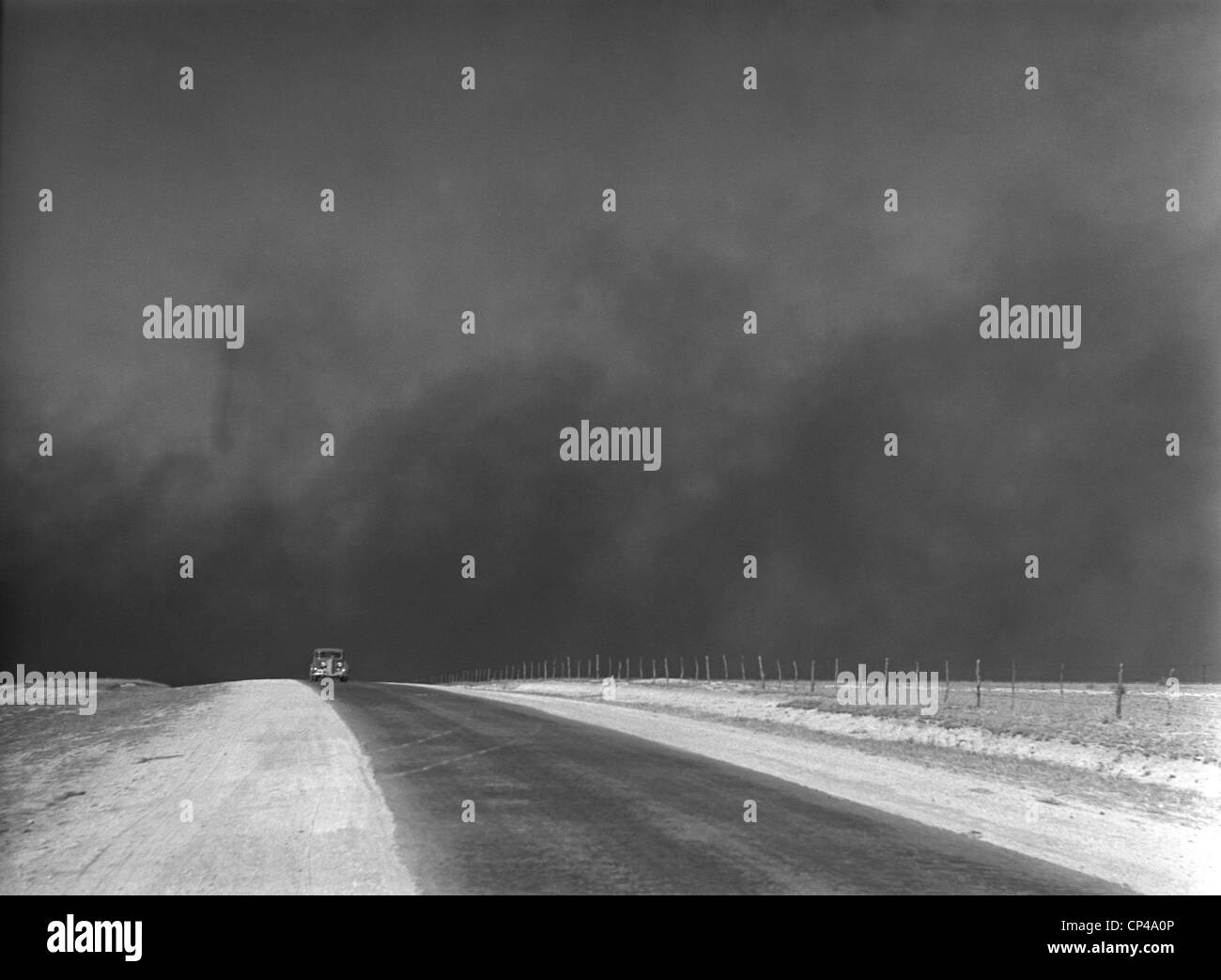 Heavy black clouds of dust rising over the Texas Panhandle. March 1936 photo by Arthur Rothstein. - Stock Image