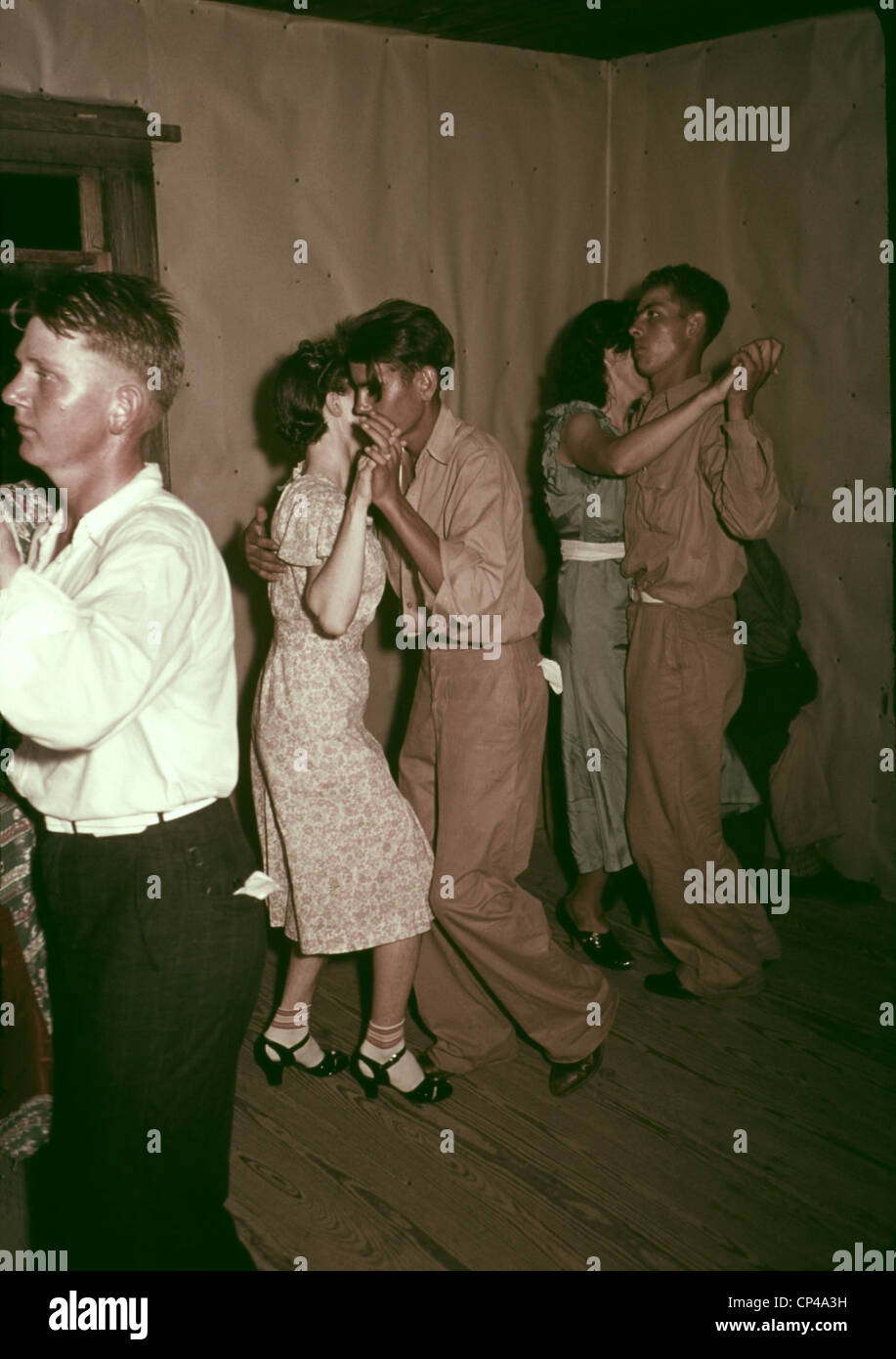 Square dance in rural home in McIntosh County Oklahoma. Ca. 1938-39. - Stock Image