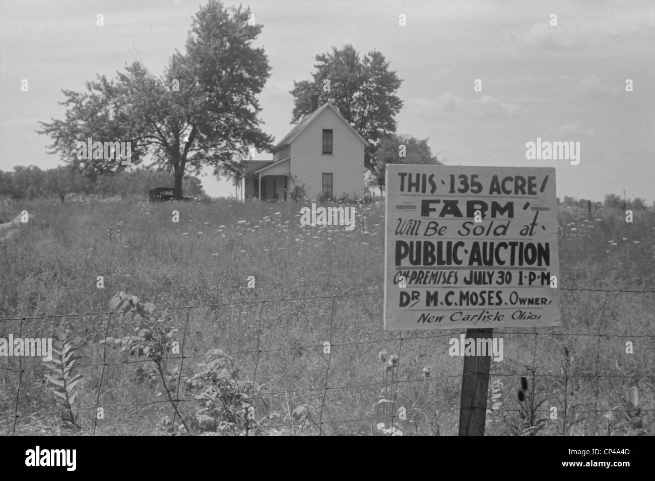 Sign advertising farm auction New Carlisle Ohio. Photo by Ben Shahn Summer 1938. - Stock Image