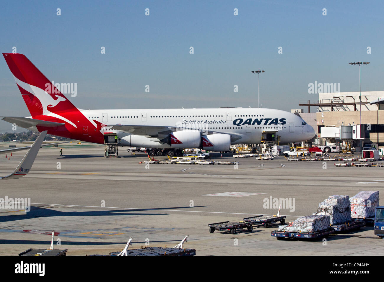 Qantas Airlines airplane on terminal at airport, Christchurch International Airport - Stock Image