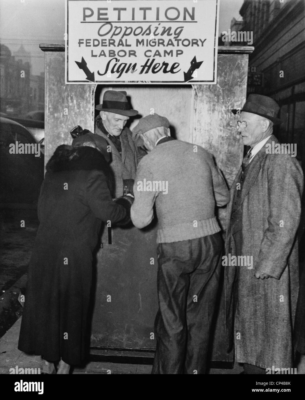 People sign a petition opposing establishment of government migratory labor camps in their community. The camps - Stock Image