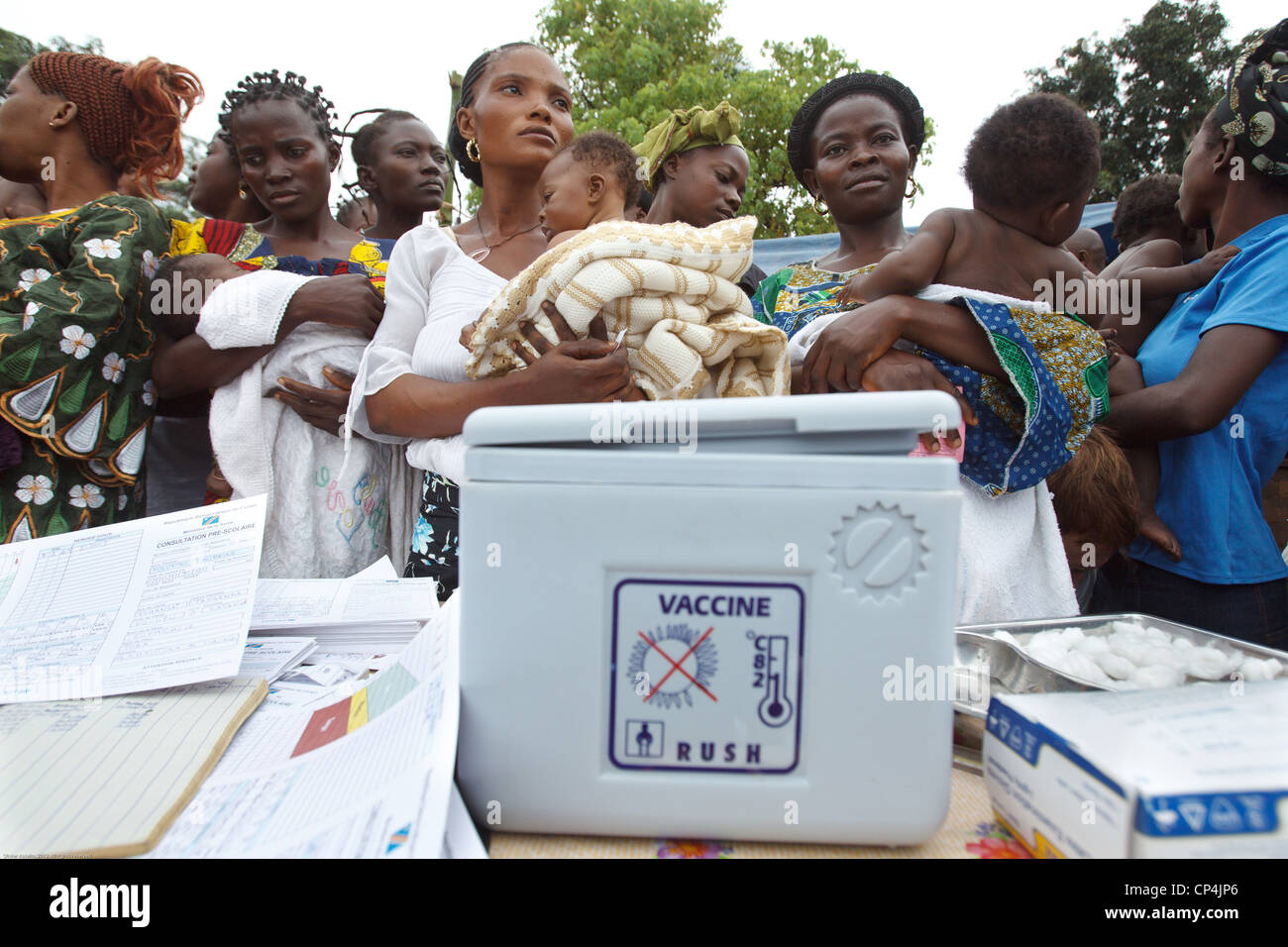 Mothers wait to have their children vaccinated during routine vaccination at the Nyunzu health center in the town Stock Photo
