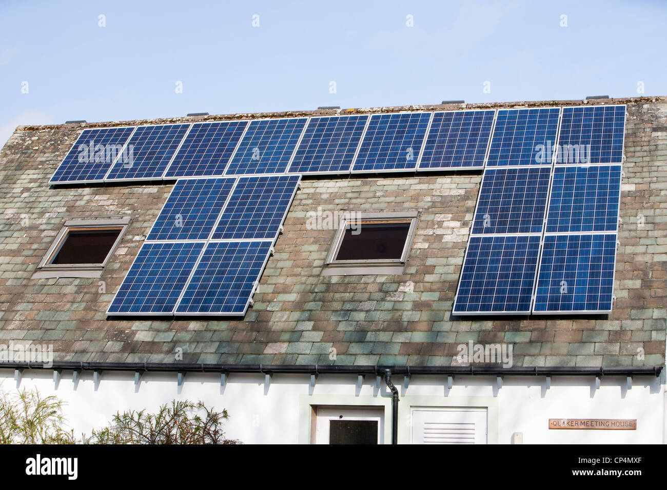 Solar panels on the roof of the Keswick Quaker meeting house, Cumbria, UK. - Stock Image