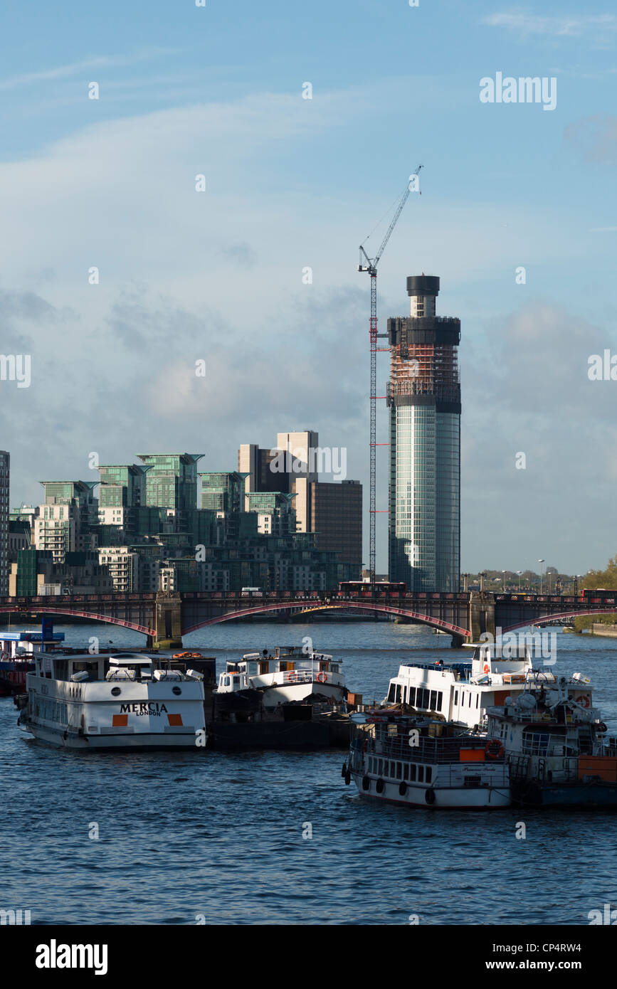 Lambeth Bridge on the River Thames, with St Georges Wharf Tower and The Tower developments in Vauxhall,London,UK - Stock Image