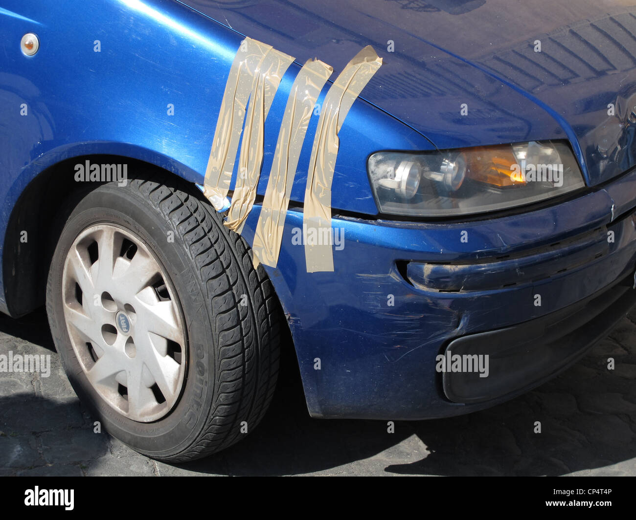 Temporary Repair For Broken Car Front Wing Bumper Stock Photo