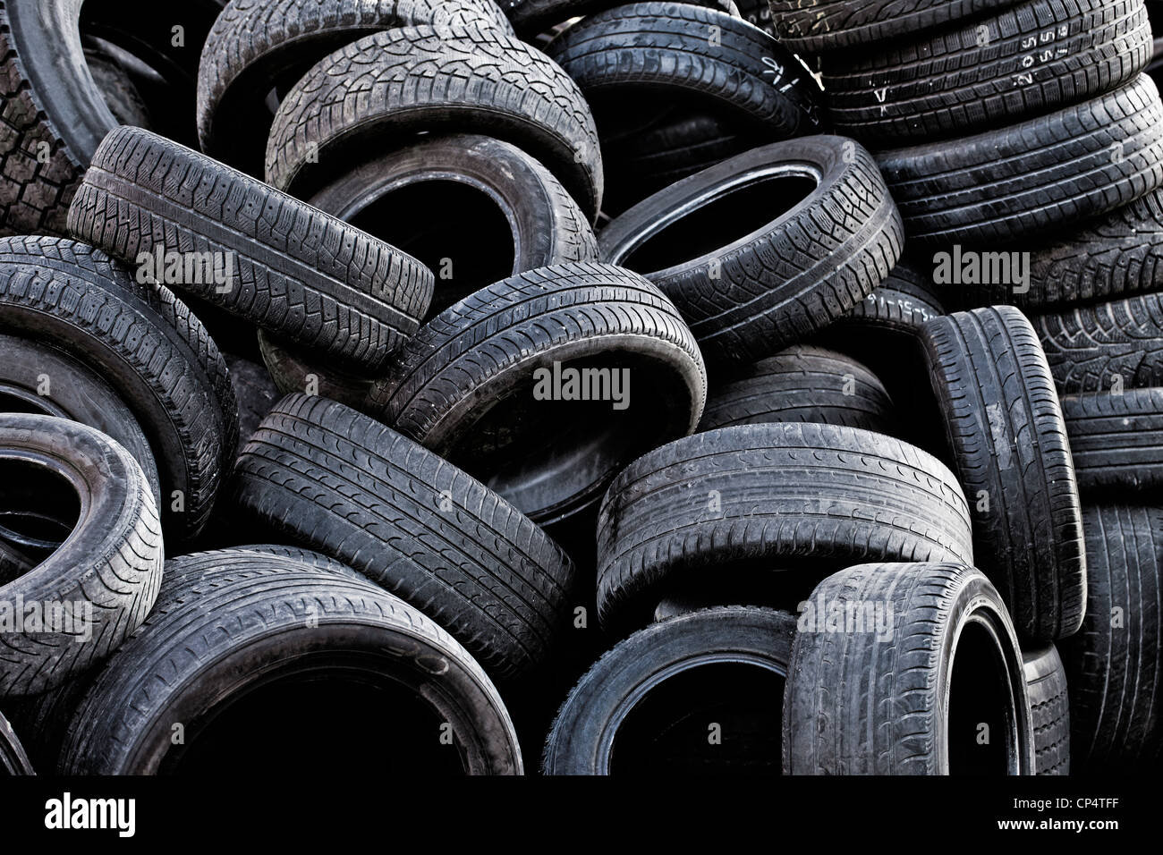 Pile of old used car tires. - Stock Image