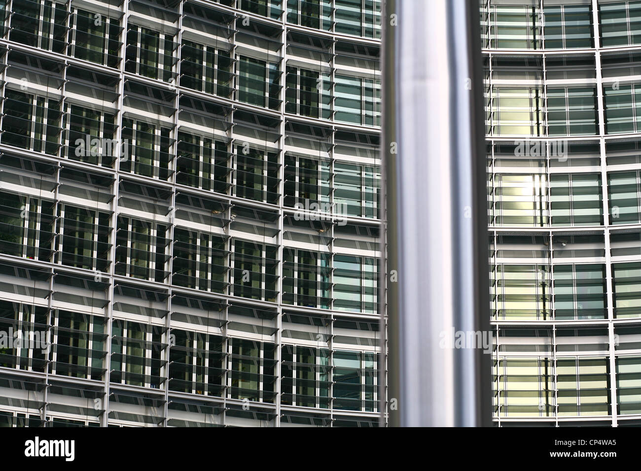 EU flags fronting the Berlaymont - an office building in Brussels,  that houses the headquarters of the European - Stock Image