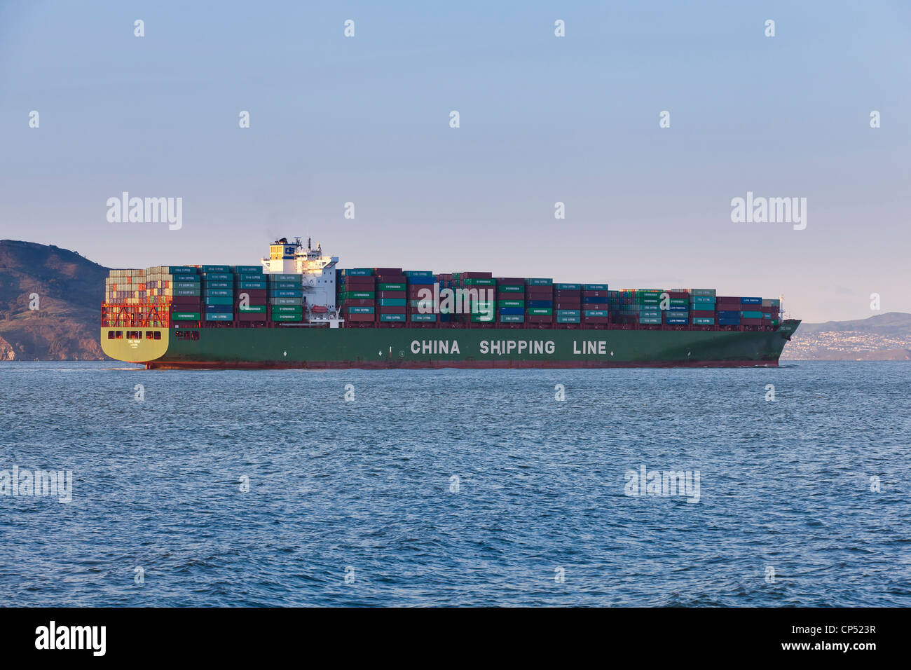 A China Shipping Line freighter ship full of cargo entering US port - San Francisco, California USA - Stock Image