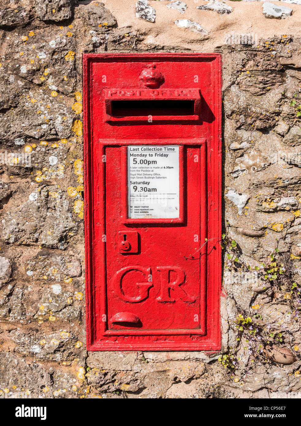 George V letter box in a wall in the small village of East Budleigh, Devon, England. - Stock Image