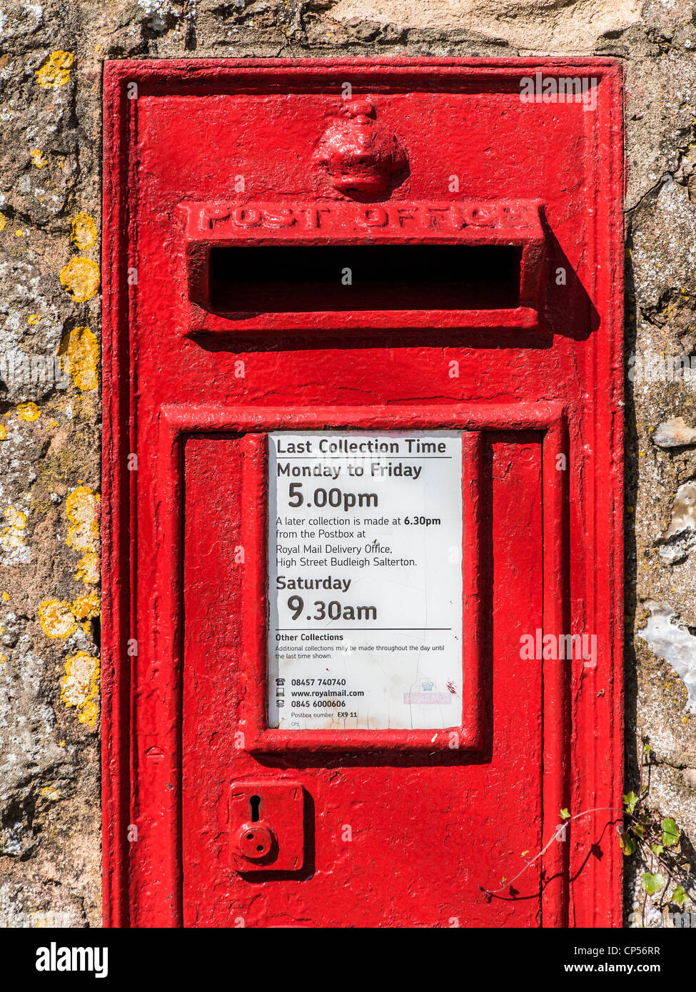 George V letter box in a wall in the small vilalge of East Budleigh, Devon, England. - Stock Image