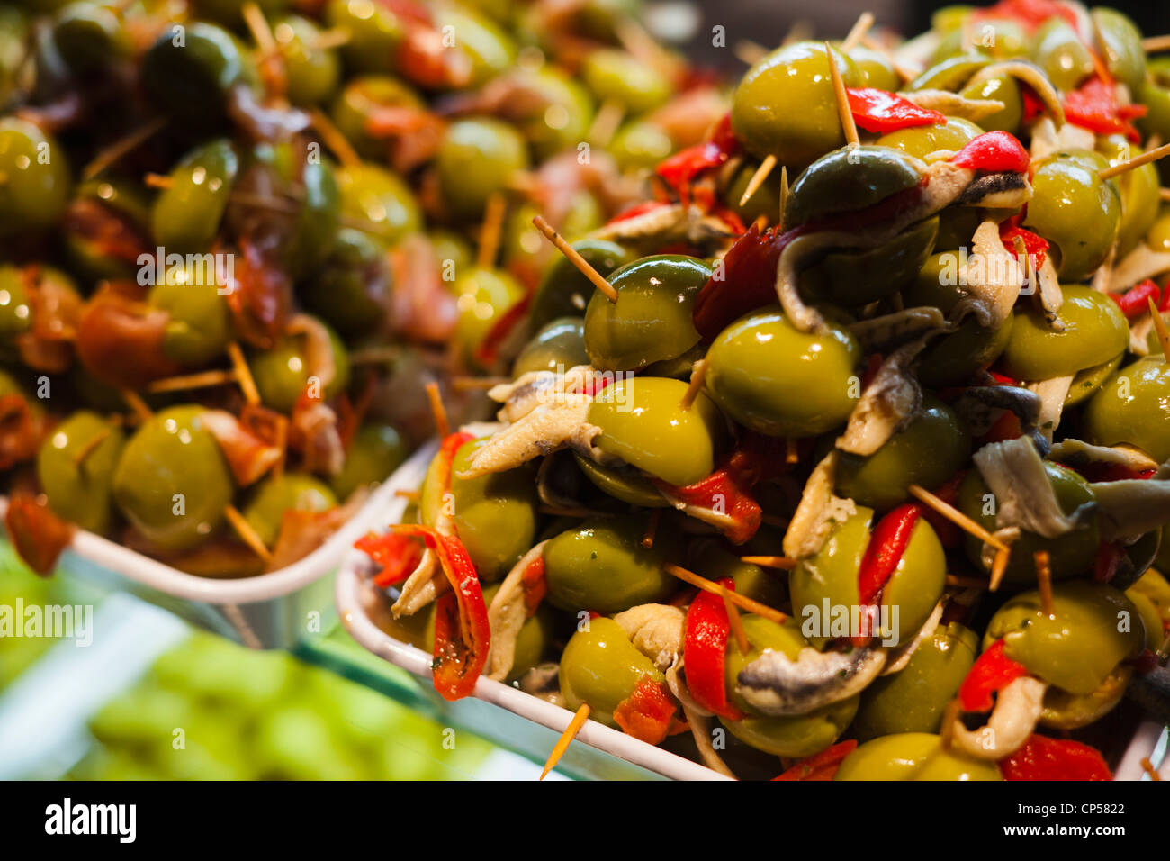 Spain, Madrid, Plaza de San Miguel, Mercado de San Miguel, artisan food marketplace, tapas made with stuffed olives - Stock Image