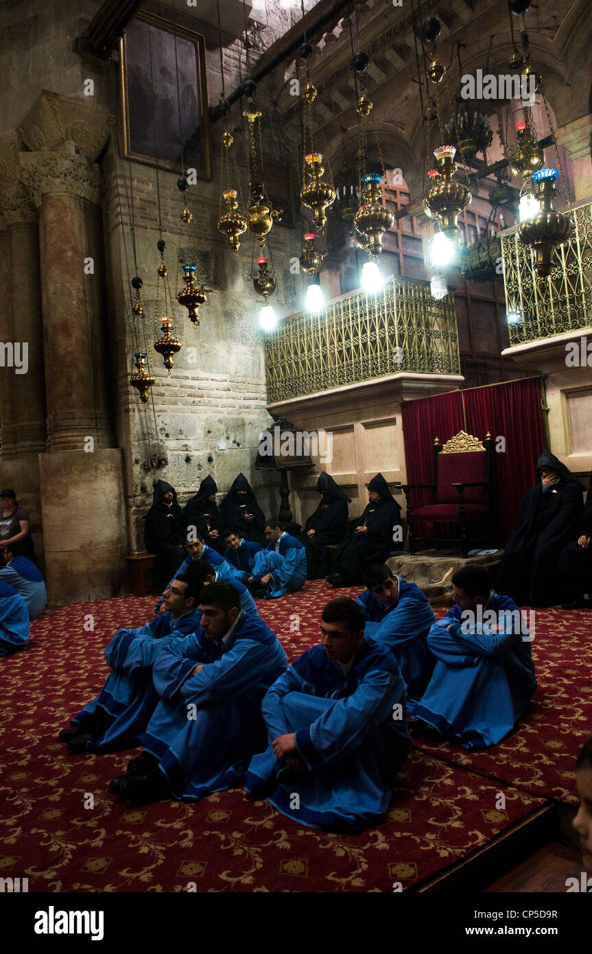 The Armenian Orthodox church holding a ceremony inside the church of the holy Sepulchre. - Stock Image