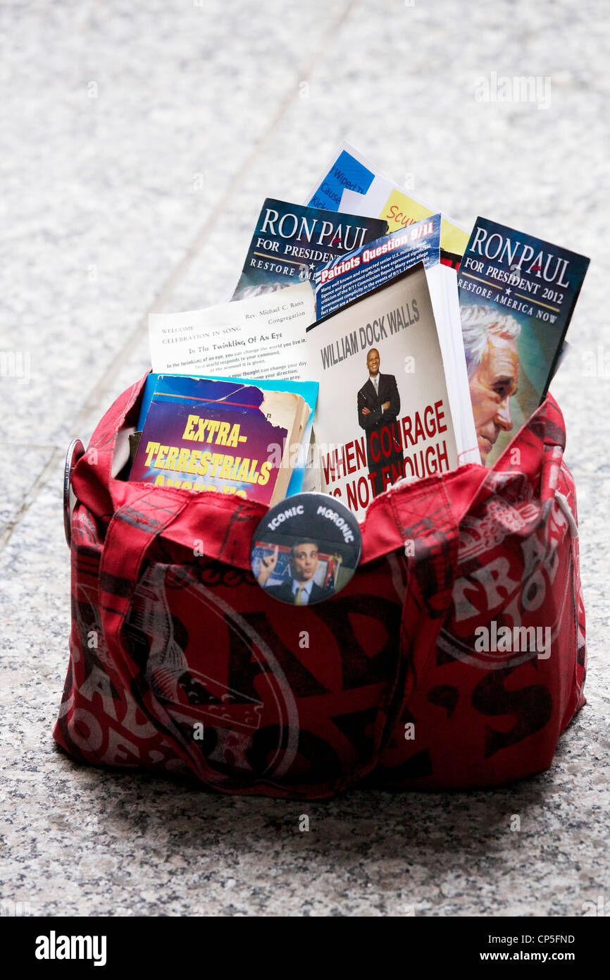 Books authored by Ron Paul and others in bag at the May Day 2012 rally at Federal Plaza in Chicago. - Stock Image