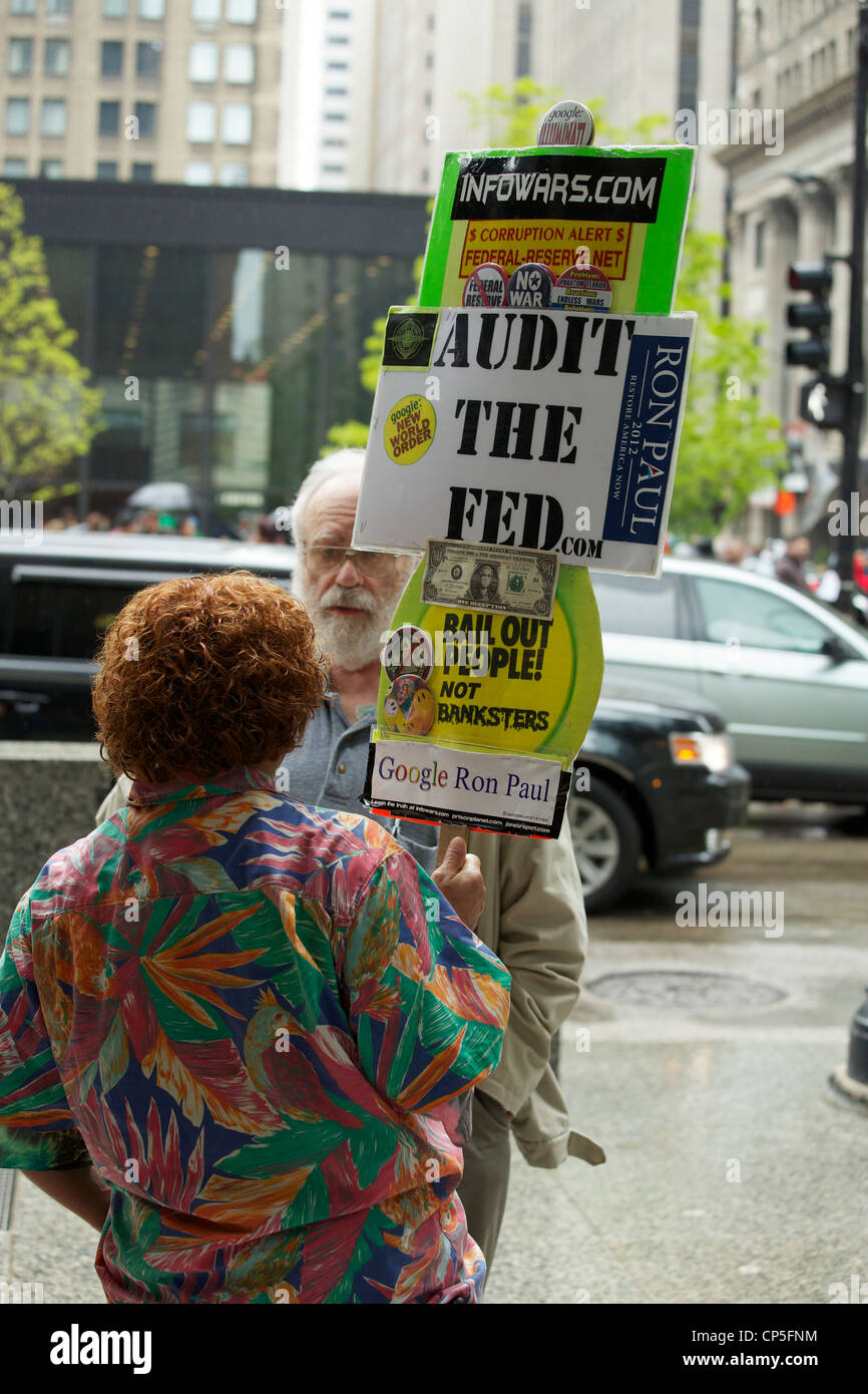 An anti-corporate anti-bank Ron Paul supporter speaks to a passer-by. May Day 2012 Federal Plaza Chicago - Stock Image