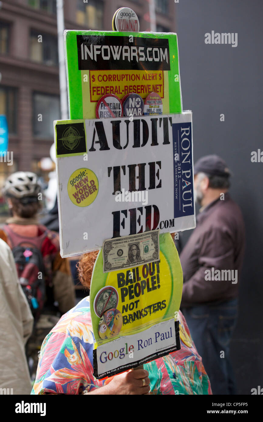 A protester holding sign with multiple conspiracy theories, Chicago May Day 2012 rally, Federal Plaza. - Stock Image