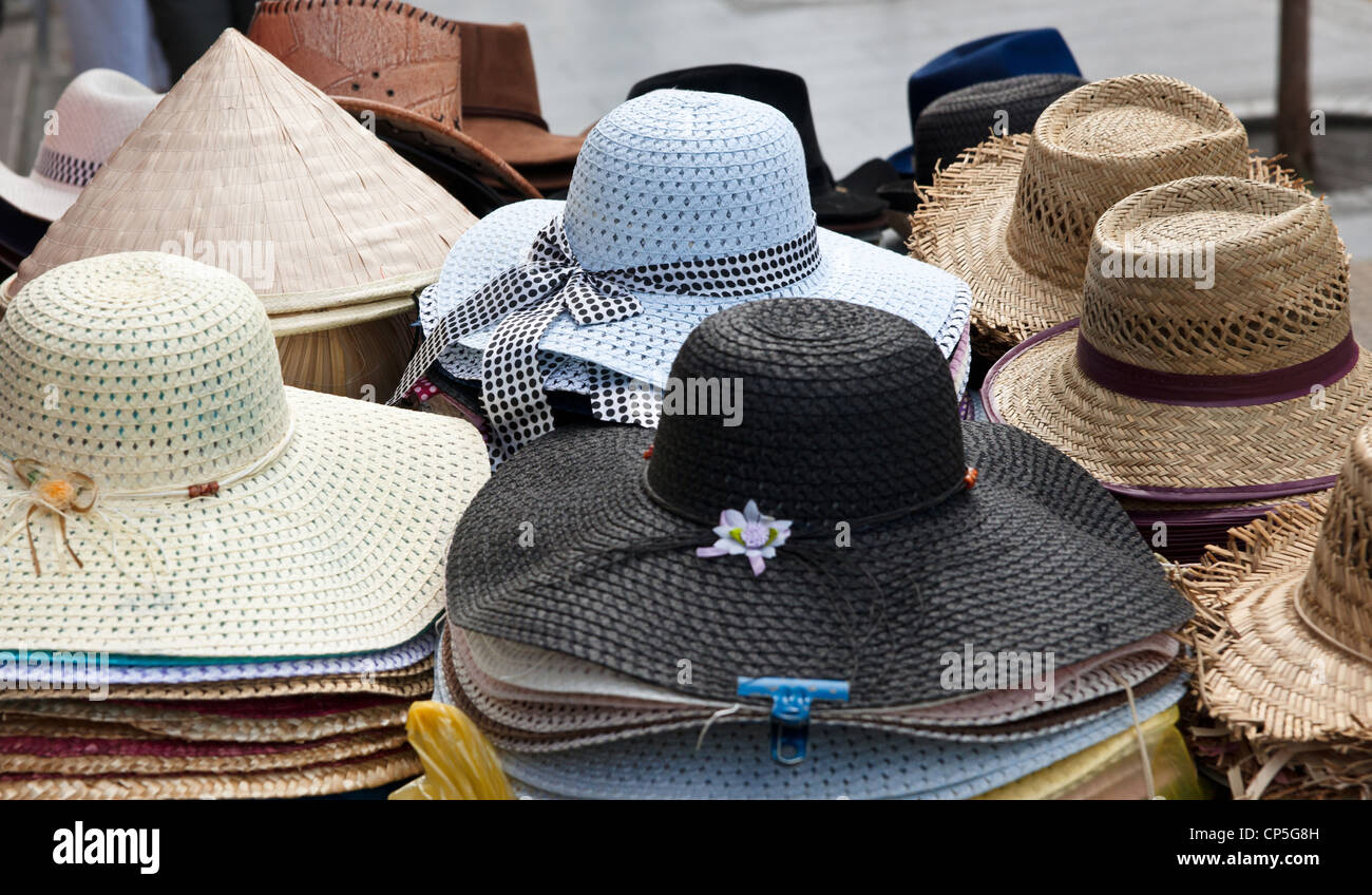 66eb70c197c4b6 lots of hats for sale in market focus is on blue hat Stock Photo ...