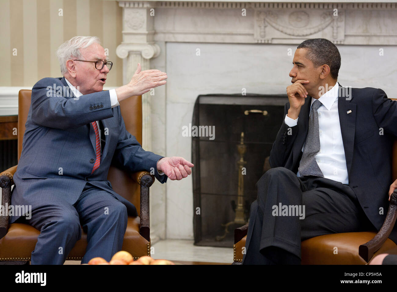 President Barack Obama meets with Warren Buffett, the Chairman of Berkshire Hathaway, in the Oval Office, July 18, - Stock Image