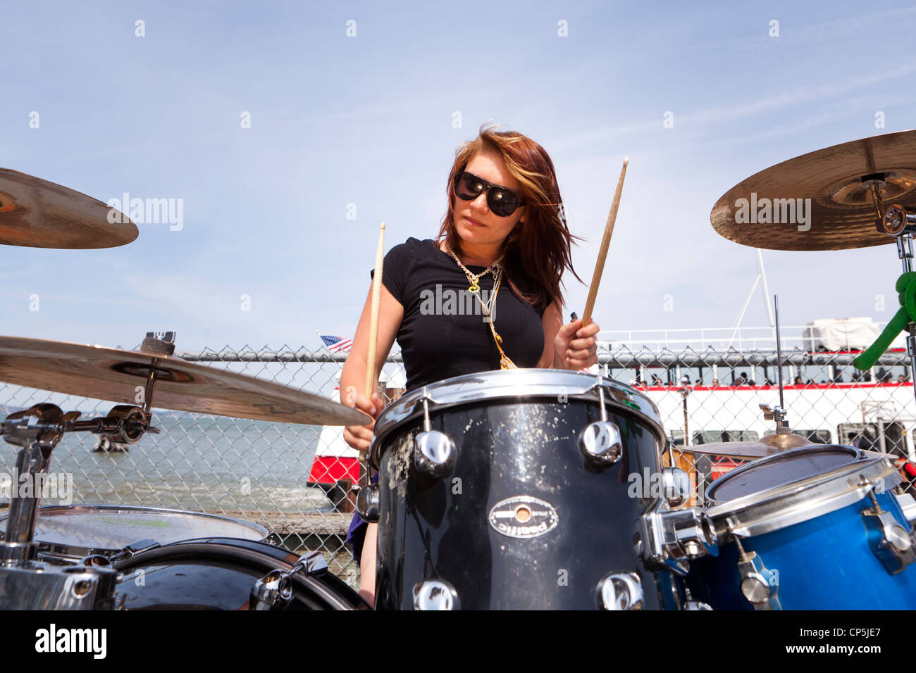 A female drummer outdoors - Stock Image