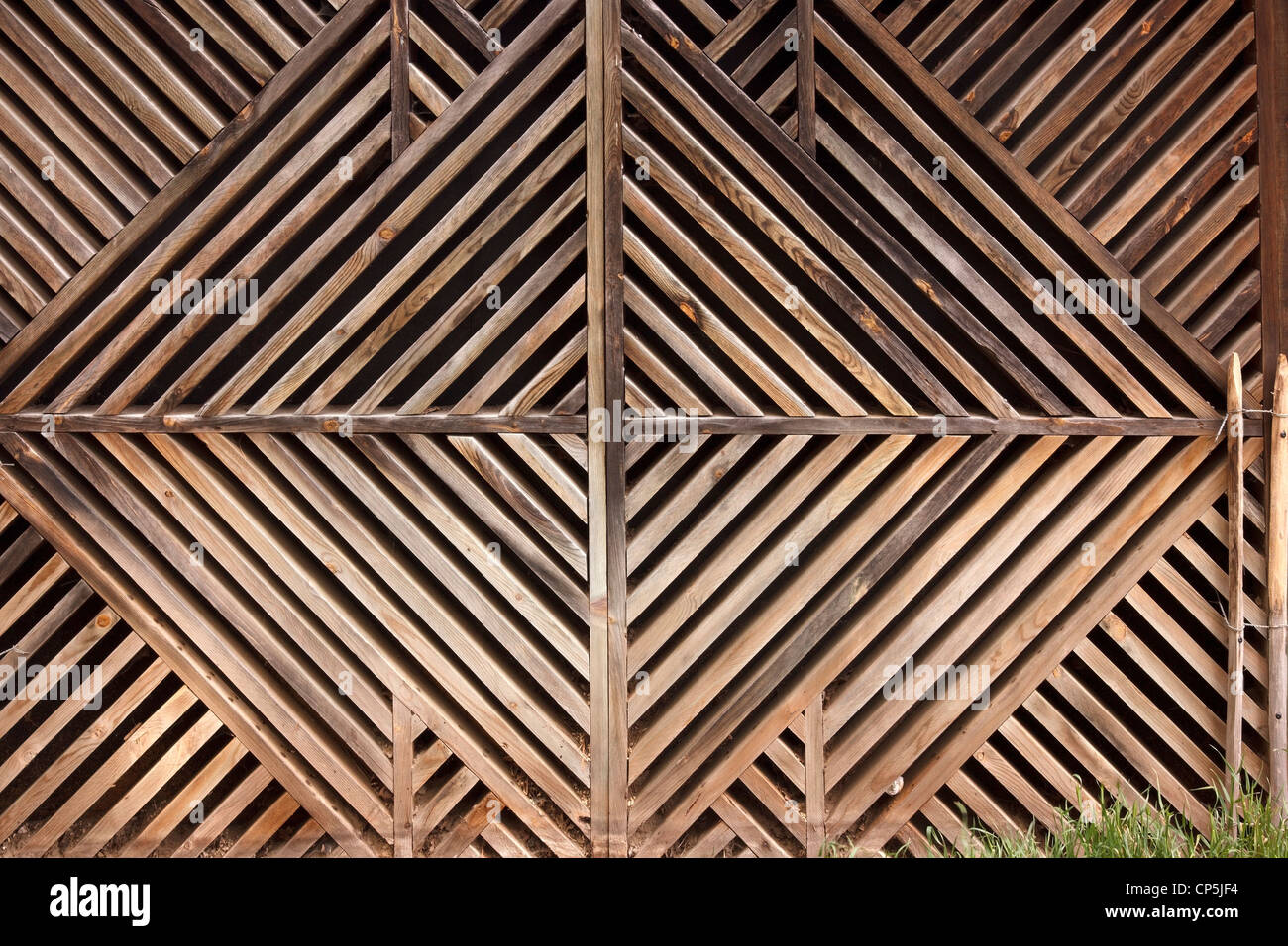 Decorative slatted wooden screen panels on utility