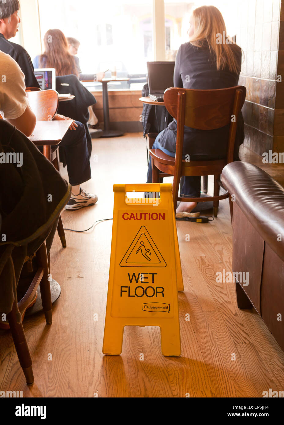 Wet floor safety sign in coffee shop - Stock Image