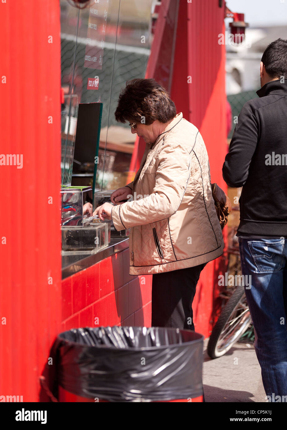 Woman at a ticket window - Stock Image