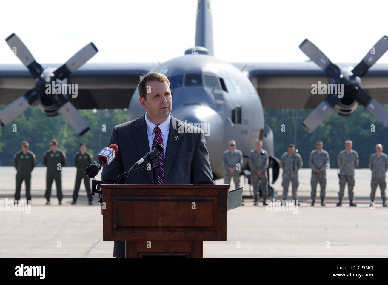 Fred Ross, vice president of C-130 Programs for Lockheed Martin, speaks to an audience attending the retirement - Stock Image