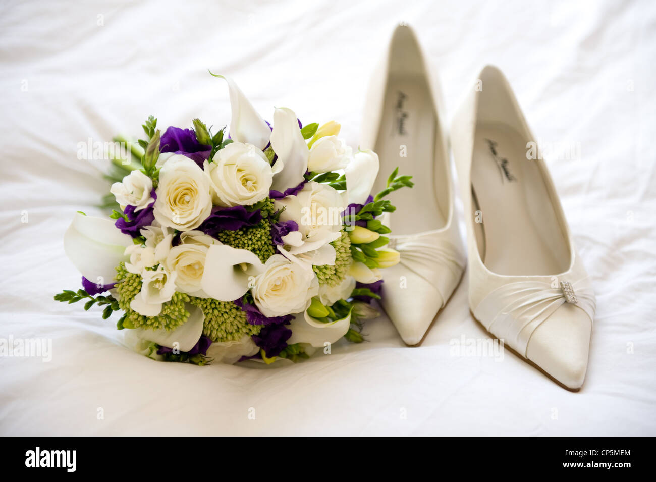 wedding shoes and flowers of the bride Stock Photo