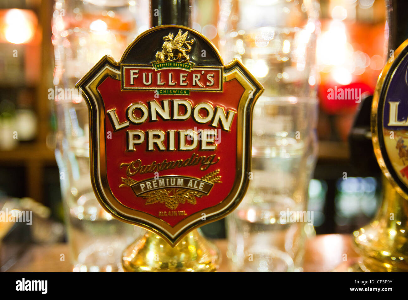 A real ale hand pump on the bar of the Euston Flyer, Kings Cross, London, UK. - Stock Image