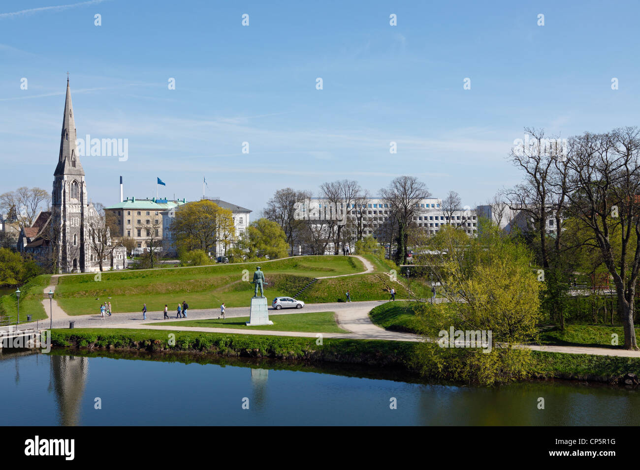 View from the ramparts of the citadel Kastellet over the moat to the English Church, St. Alban's, and the domicile - Stock Image