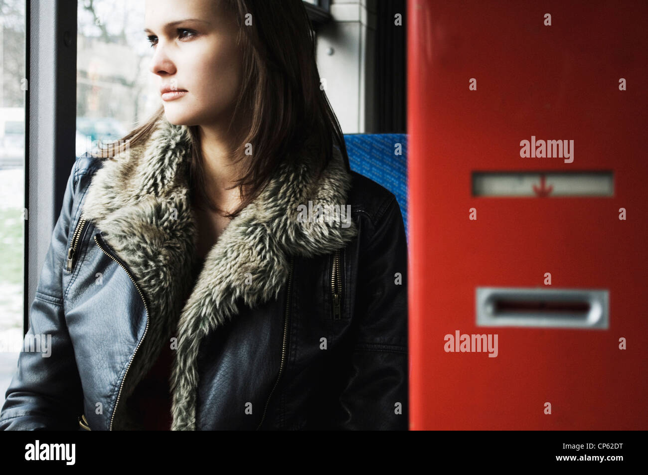 Germany, Duesseldorf, Young woman in public bus - Stock Image