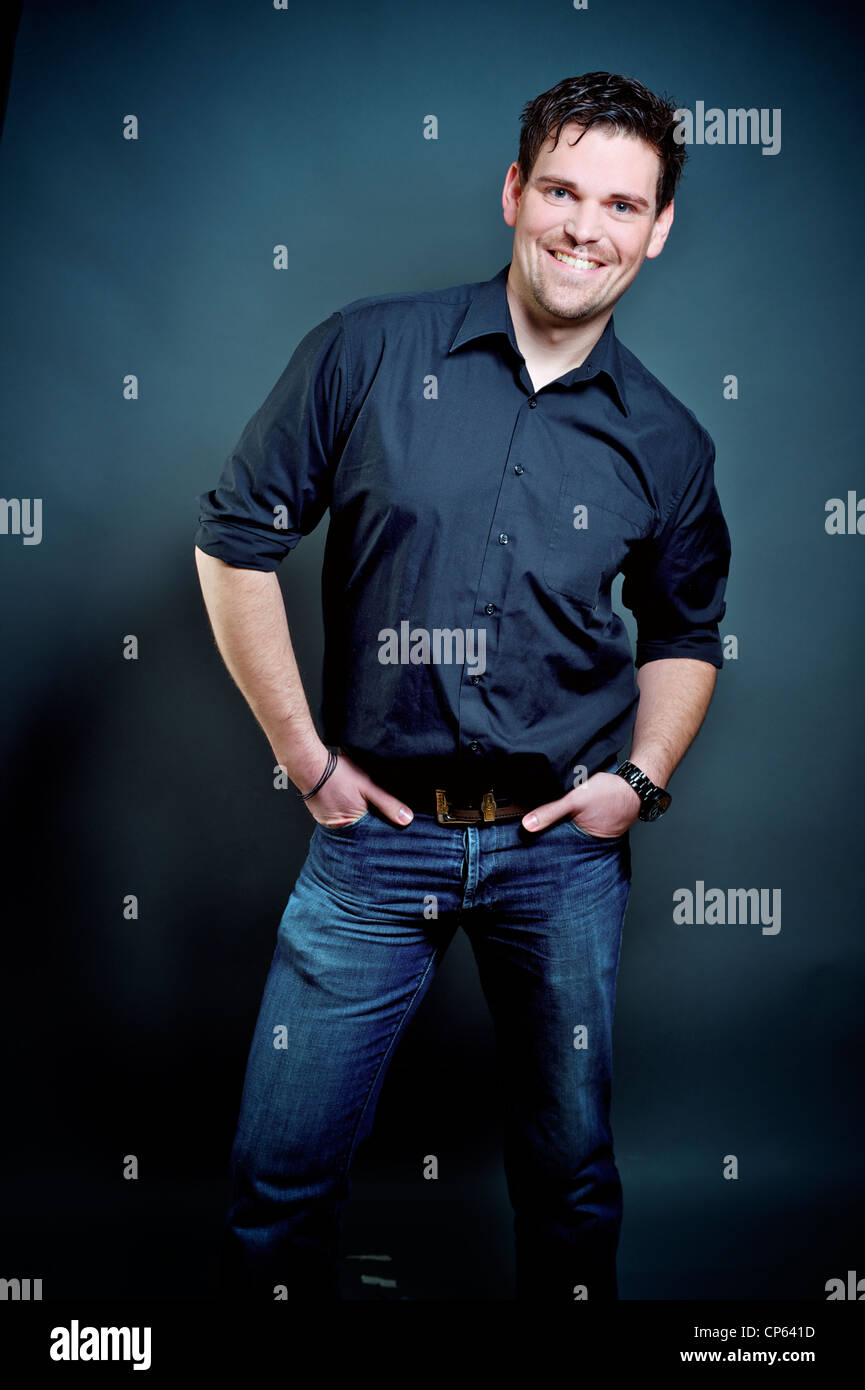 579d1fac790 friendy young man in jeans and blue shirt