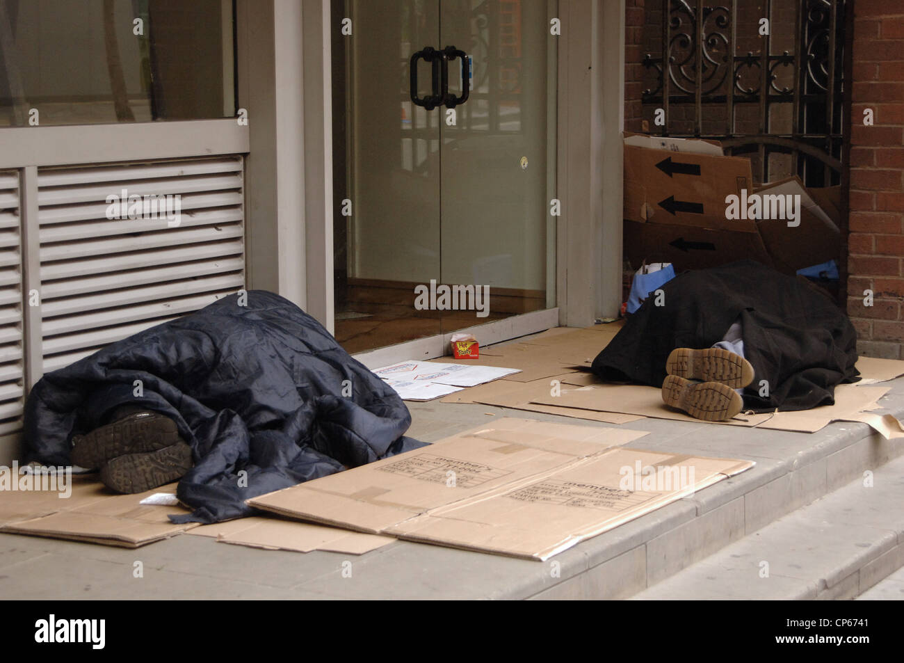 United Kingdom. London. Homeless sleeping in the doorway of a building. - Stock Image