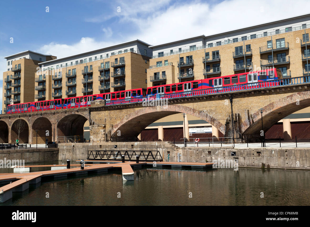 Brick viaduct carrying the Docklands Light Railway, at the Limehouse Basin, Tower Hamlets, London. - Stock Image