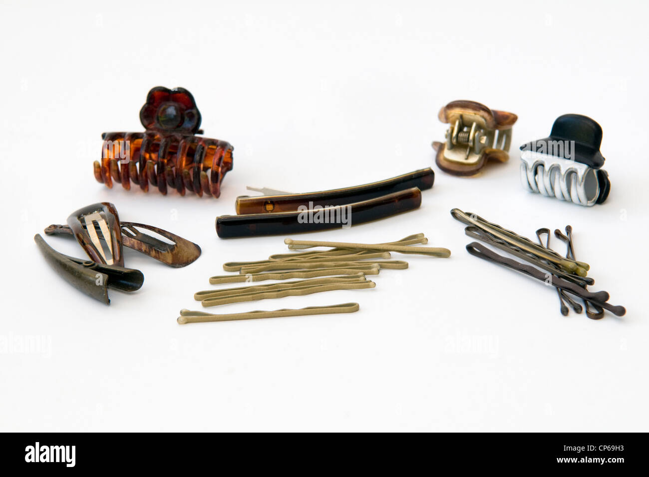 Selection of hair grips and clips against a white background - Stock Image